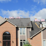 House having roof replaced depicting new roof price factors